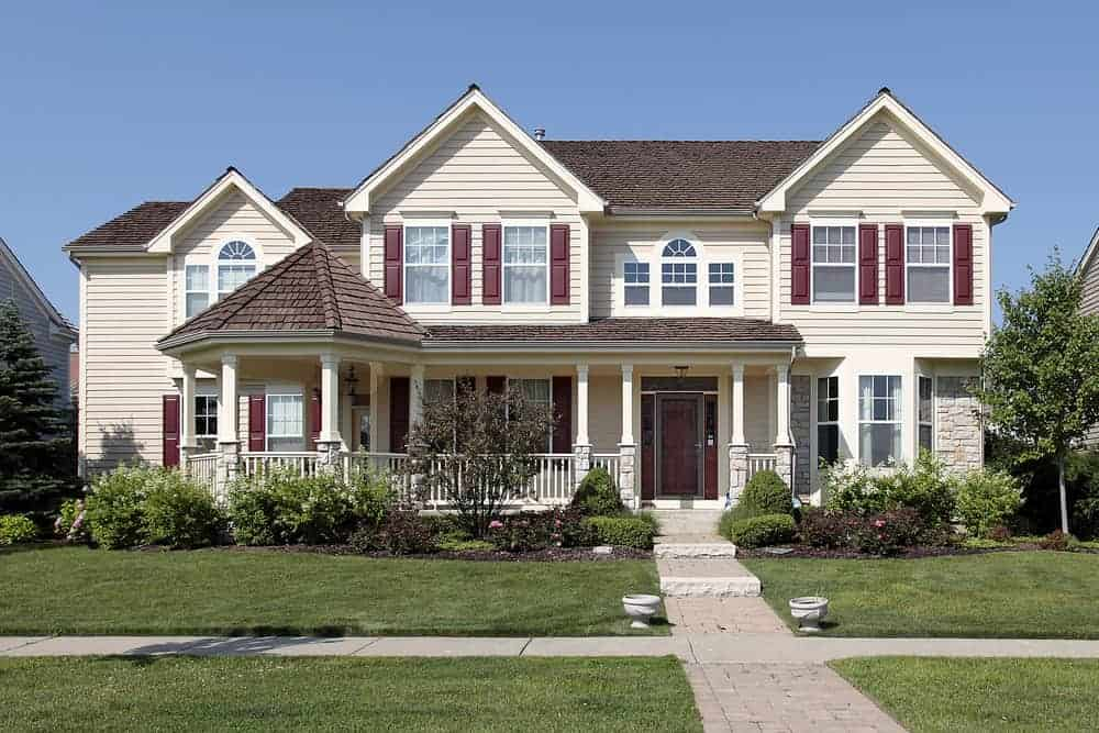 Here's an example of a new suburban house with burgundy shutters that match the burgundy front door. I wish the home was painted white... then the burgundy would look fabulous. In this case, black or dark gray would have been better. Perhaps even navy blue shutters.