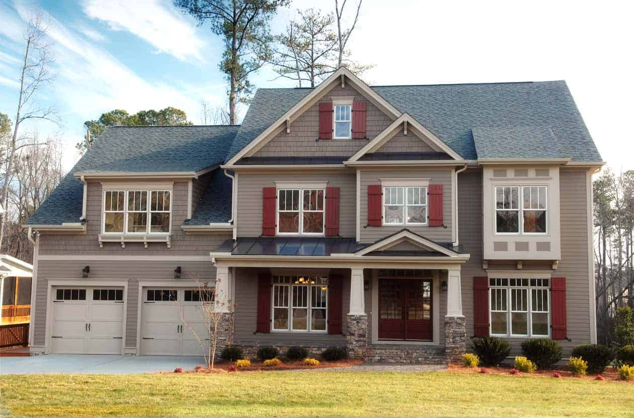 Here's an example of a newer style suburban home with exterior shutters. I really think black or dark gray shutters would look much better than the red here. It's not that I don't like red shutters; it's just that I don't think red works the best with the light brown exterior.
