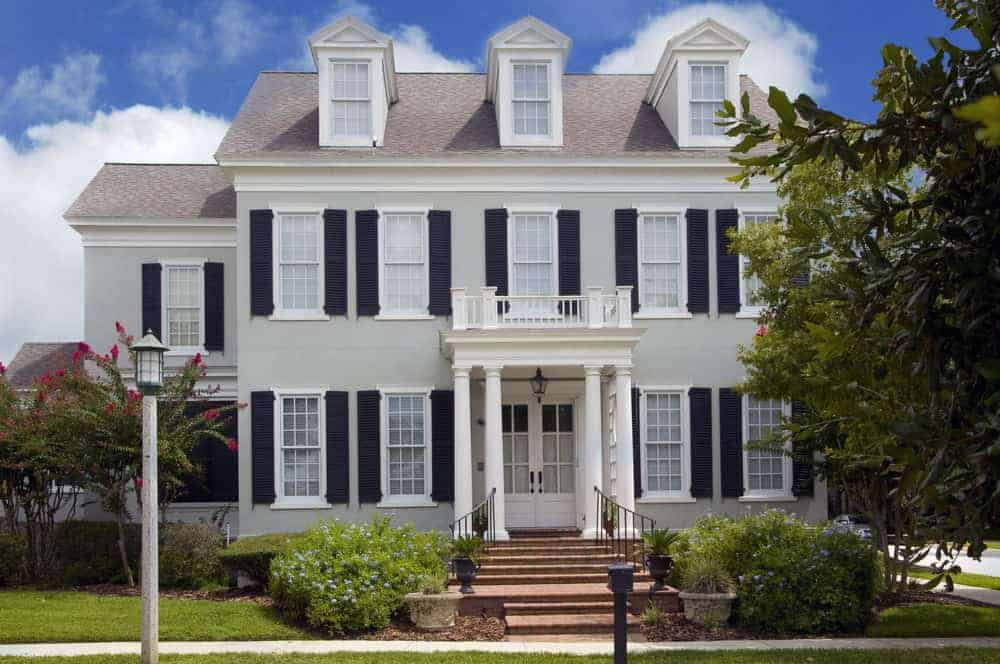 Grand light gray home with black shutters. I love this light gray exterior (but then gray is a popular home color - both inside and out right now). The contrast is excellent. Of course this is a classic residential style that will always look great.