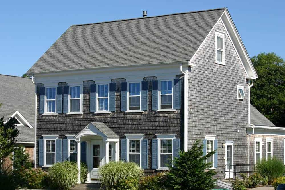 Beautiful wood shingle exterior home with blue shutters. See, blue shutters look amazing. I love them on this house with natural wood exterior and white trim.