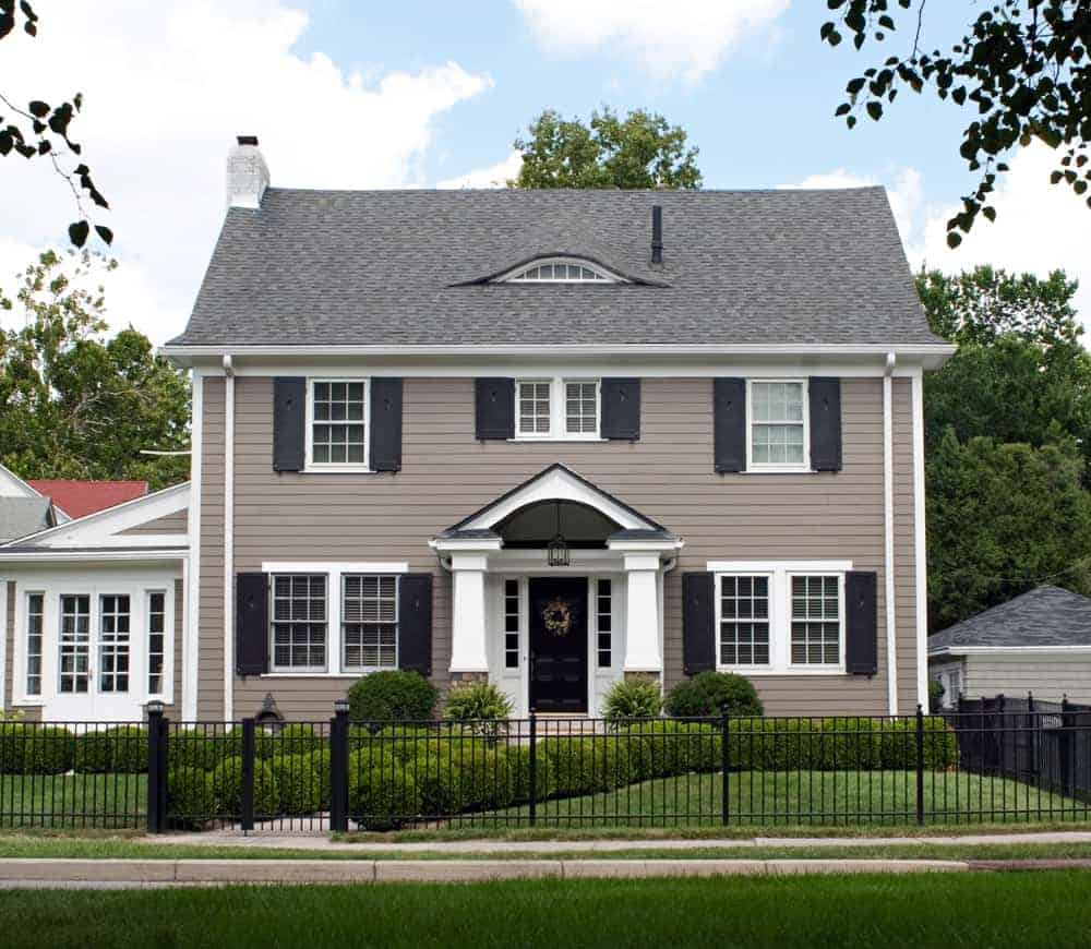 Here's a classic example of a home where exterior shutters look terrific. I quite like the black shutters on medium dark gray.