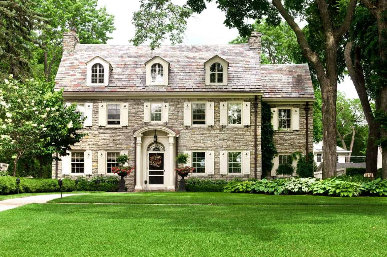 Here's another example where blending the exterior shutters works well instead of using them to create contrast. However, instead of color contrast, the shutters here create texture contrast so they do stick out. The home's stone exterior is very textured whereas the shutters are smooth. It's a smart concept which works great.