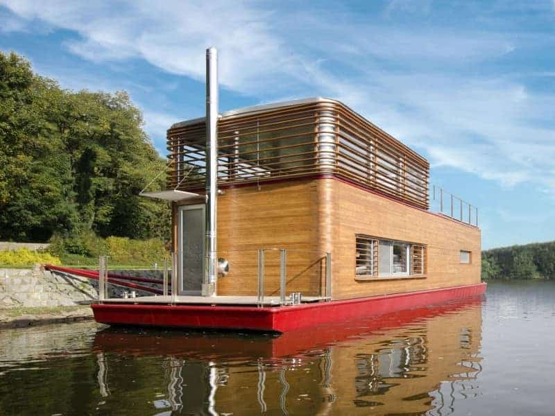 A houseboat with a stylish wooden exterior.