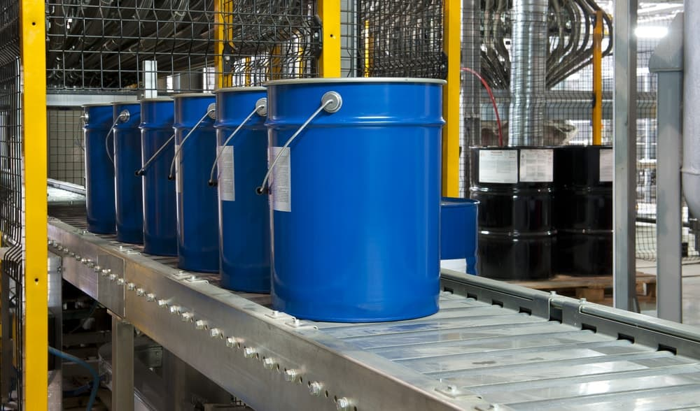 Blue, extra large buckets used for industrial purposes.
