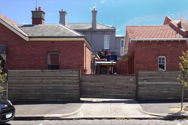 An innovative home renovation. Its exteriors are made of red brick tiles.