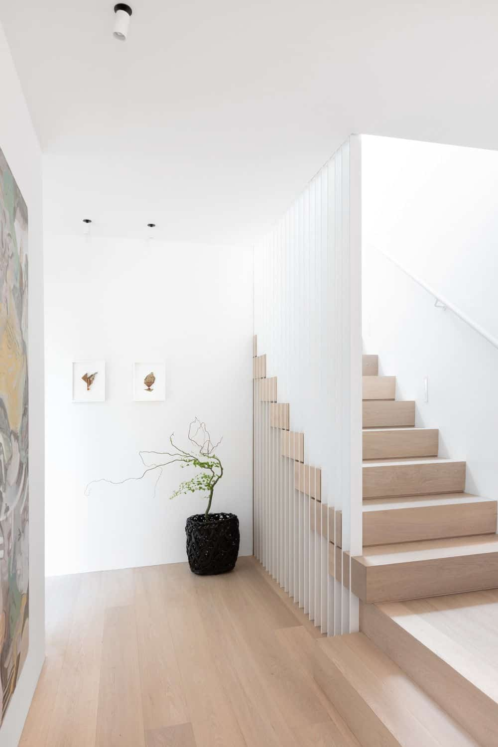 Hallway leading to other indoor amenities and a staircase leading to the home's second floor. Photo credit: Ema Peter