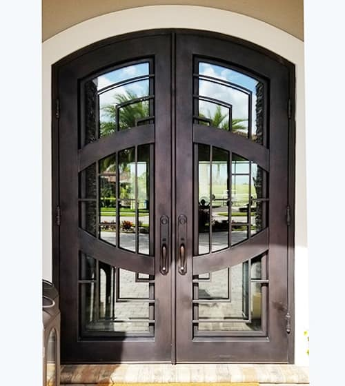 Wrought iron door with wide mirror glass inside.