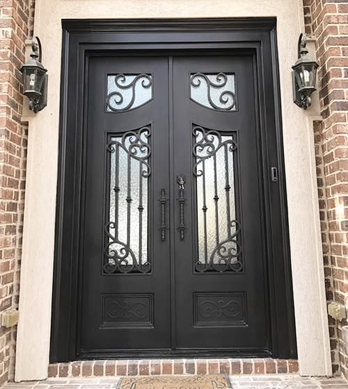 Black wrought iron door with lamps on both side.
