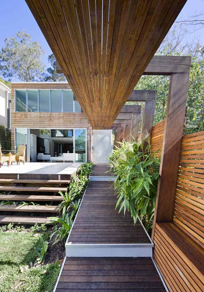A modern home with a wooden exterior, along with gorgeous outdoor areas.