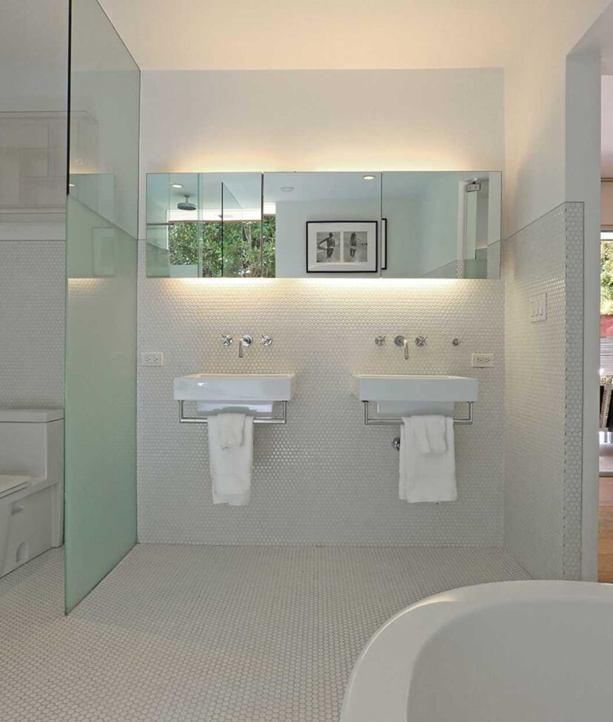 The master bath is complete with a bathtub, two sinks, toilet and a shower area.