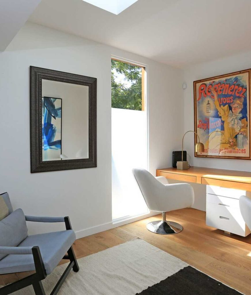 The home also has a home office featuring a built-in desk, shelves and stylish wall decors.