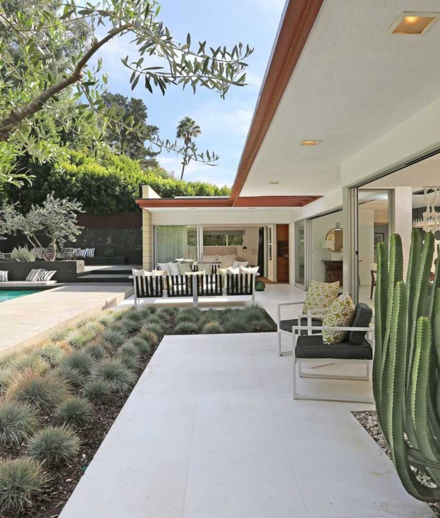 The extended patio is as long as the swimming pool's length.