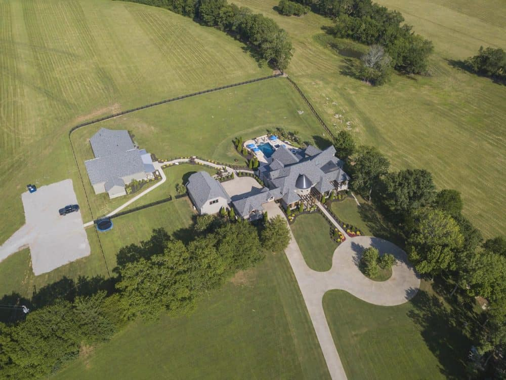 Another aerial view of the property featuring the beautiful house.