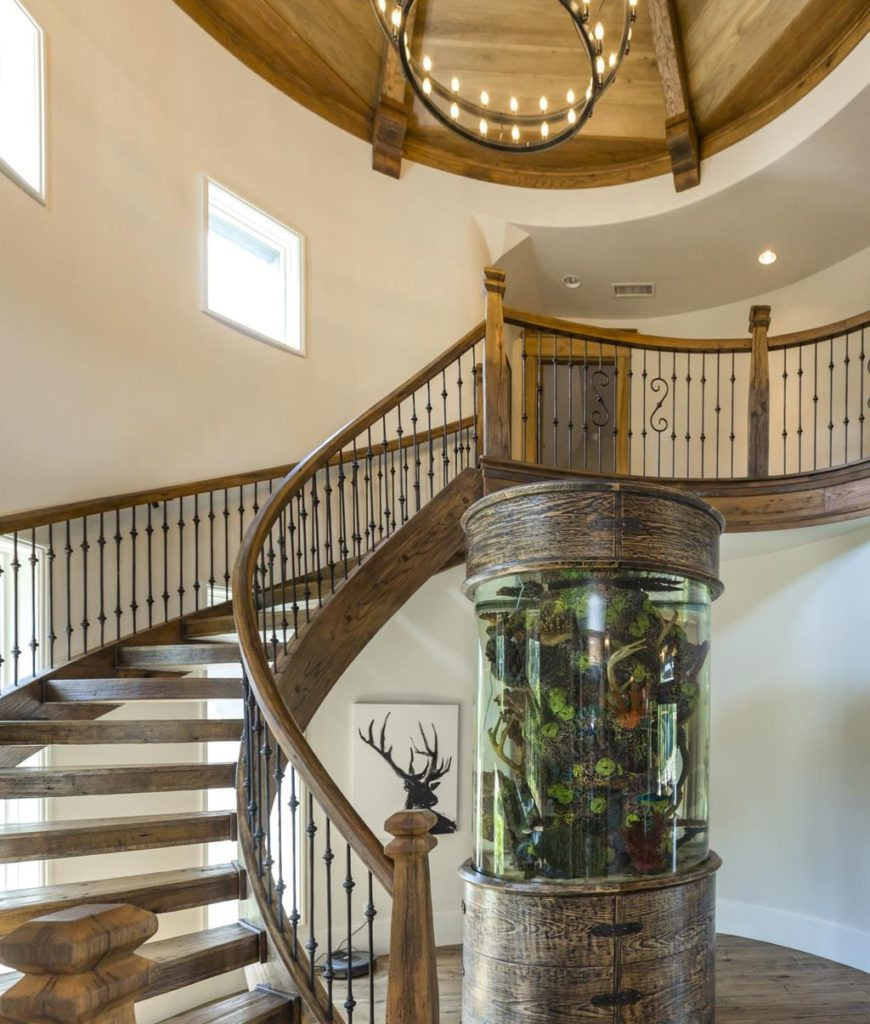 The entry features a huge customized fish tank along with a grand chandelier.