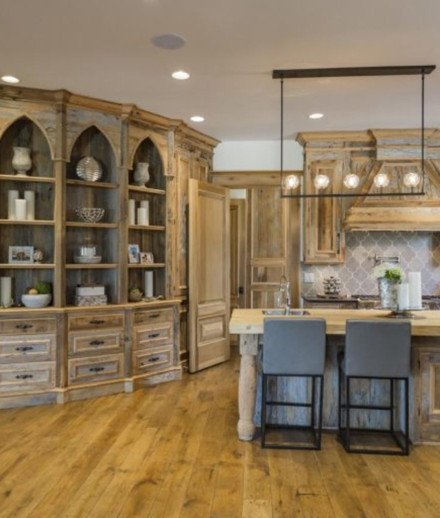 The kitchen features an old rustic style along with a breakfast bar located on the center island.
