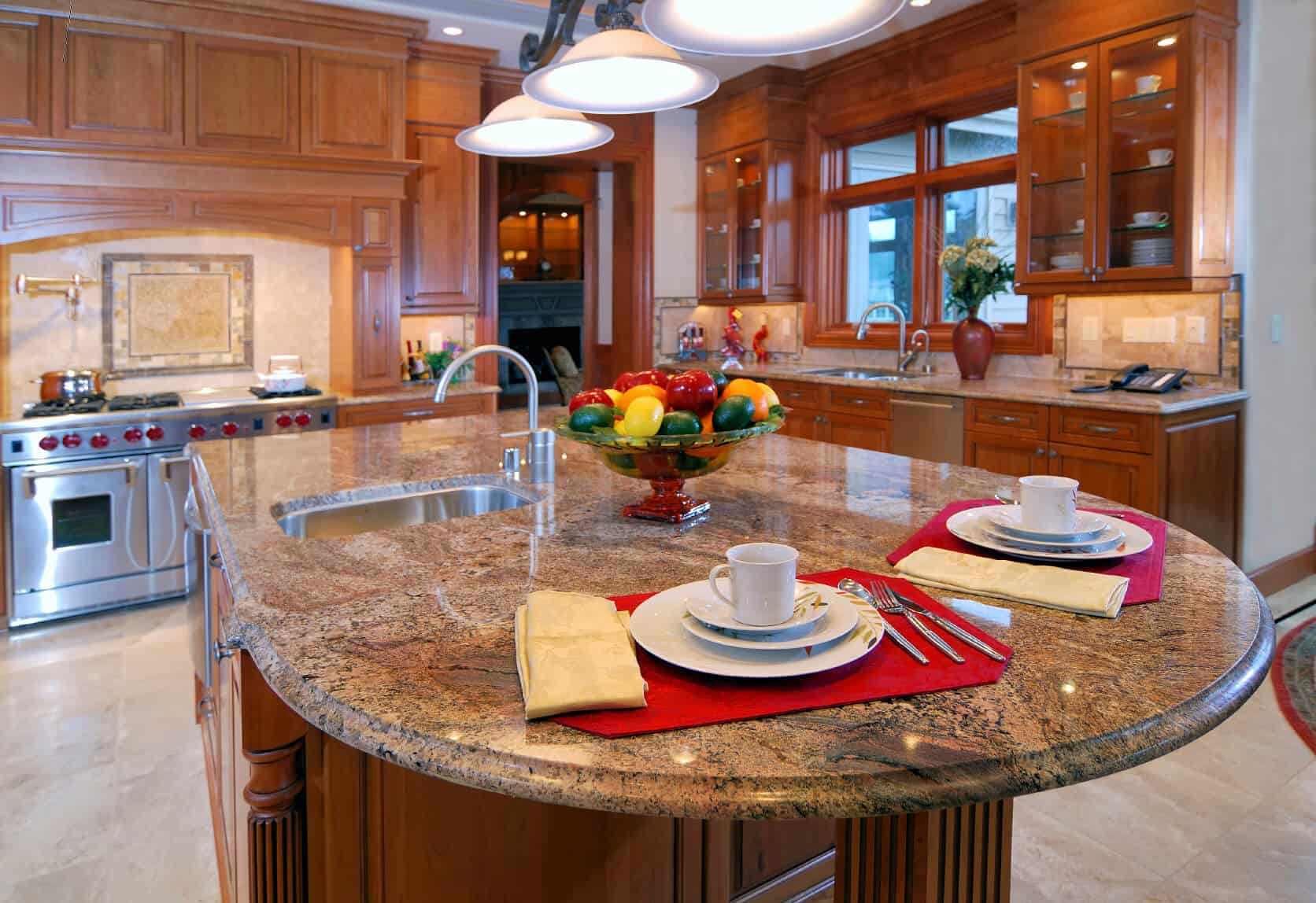 Rich Patterned Marble Countertop Extends To Round Dining E On This Natural Wood Island
