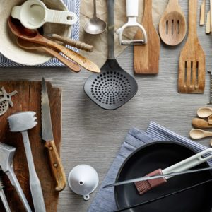 Different kinds of kitchen tools on one table.