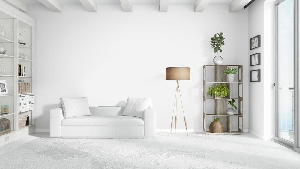 A white living room makes it very convenient for visitors to come in to the house and relax.