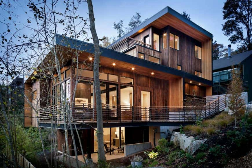 Large modern house with a wooden exterior. It has a gorgeous interior as well.
