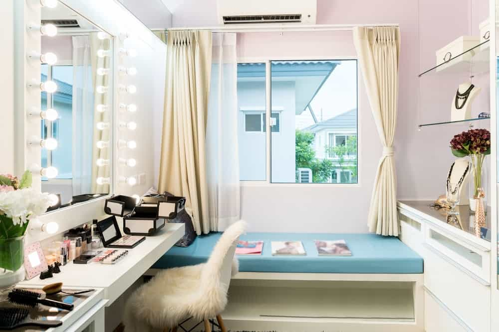 Make-up vanity with a huge mirror with LED lights.