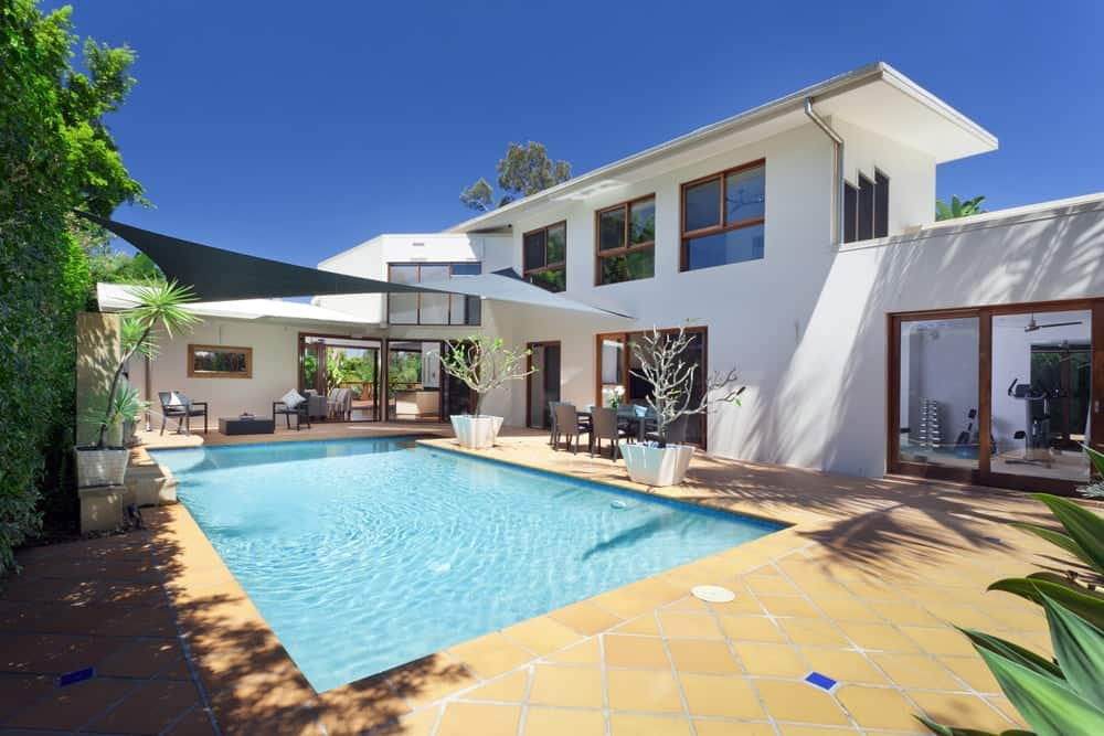 Spacious mansion with backyard swimming pool and outdoor recreational space.
