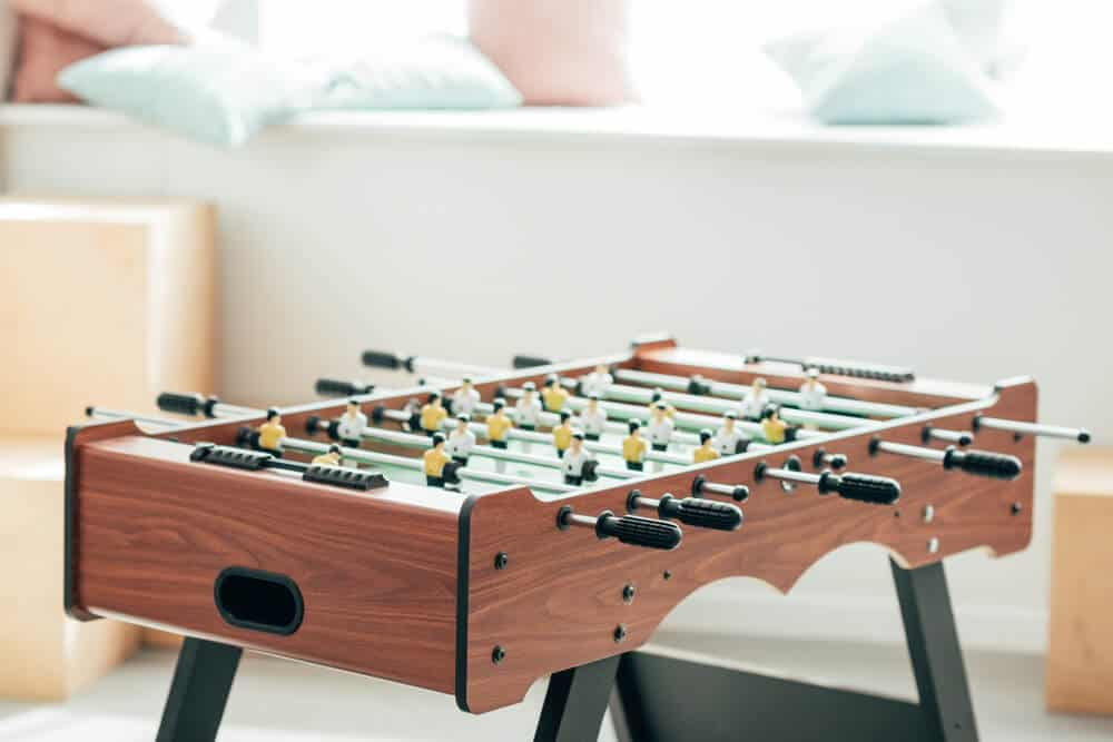 Smooth and fine foosball table made of manufactured wood.