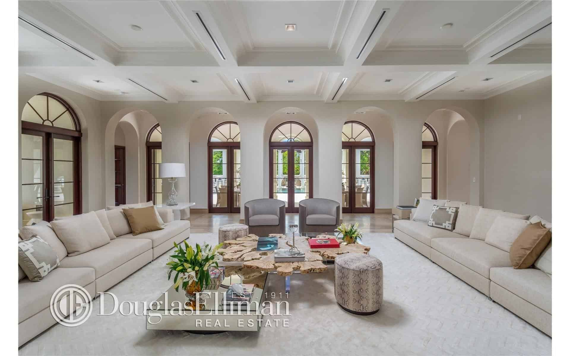 Another Living Room Boasting A Huge Space And A Carpet Flooring As Well As  Comfortable Long Pair Of Couches And Coffered White Ceiling.