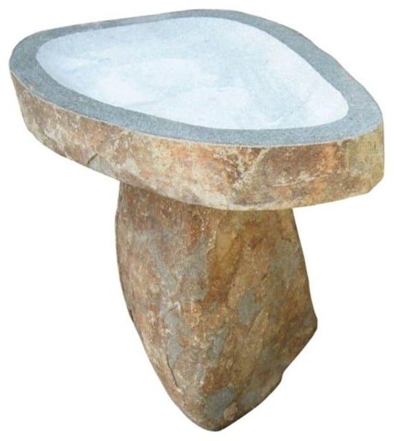 A medium-size, stone bird bath in a natural tone.
