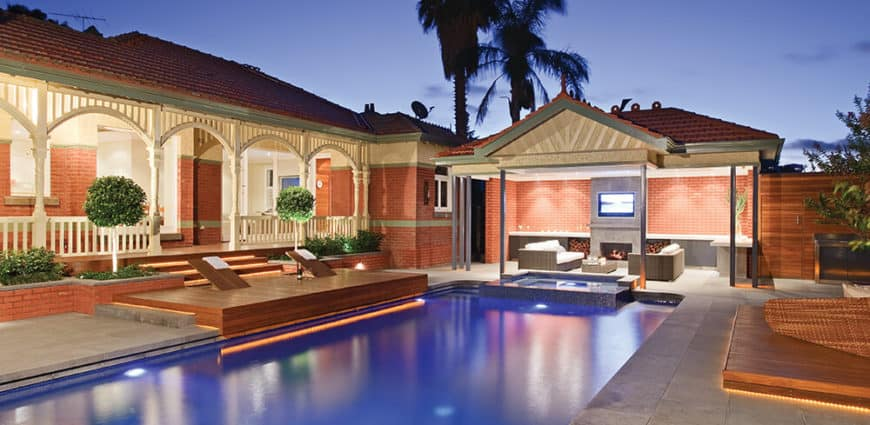 This home's outdoor features an outdoor living space, a swimming pool along with sitting lounges.