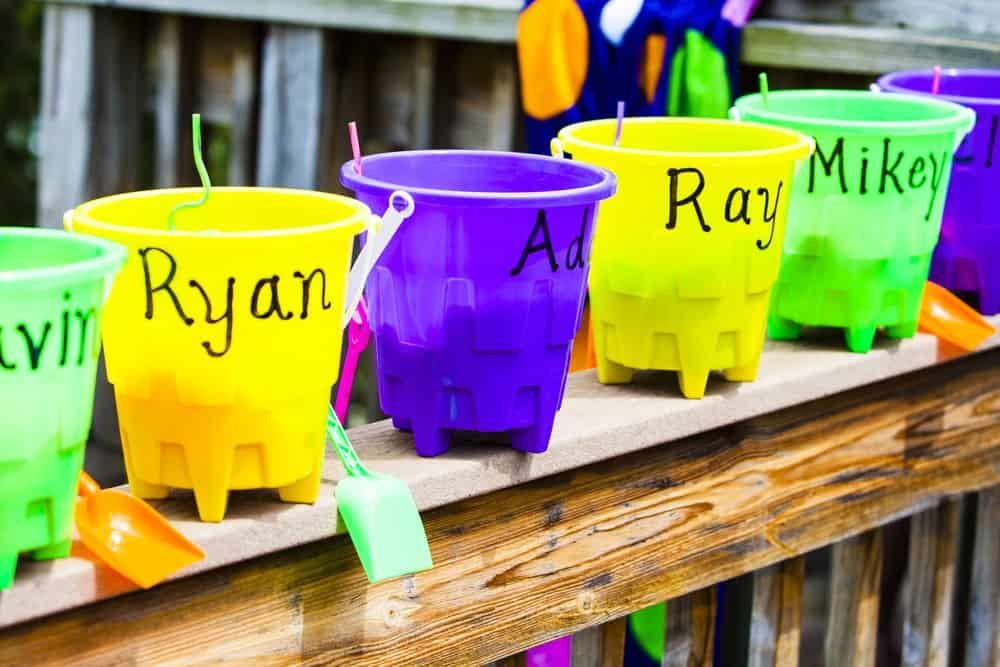 Small and colorful plastic buckets for party favor.