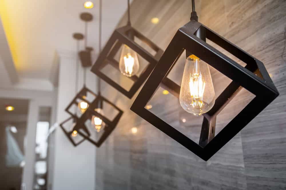 Decorative pendant lights with cube frames.