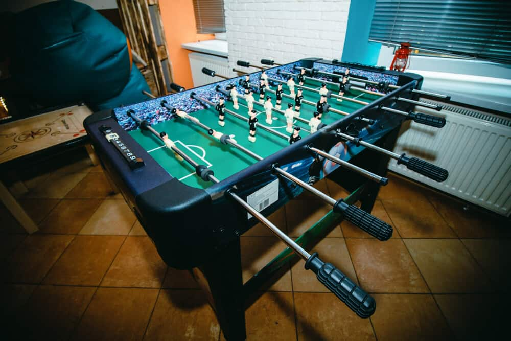 Black, lightweight foosball table made of plastic.