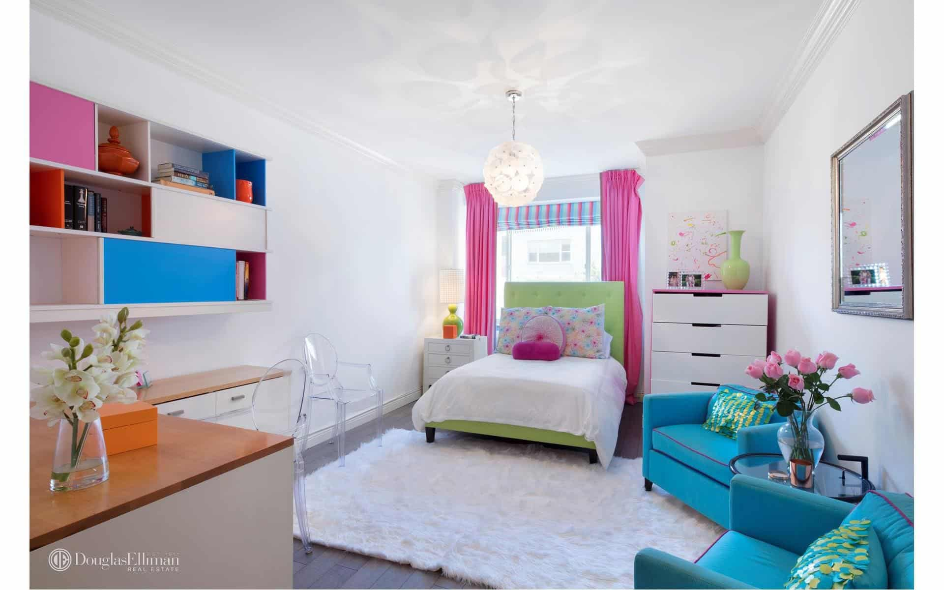 Thereu0027s Also A Kids Bedroom Featuring Colorful Furniture And A Classy Rug  Along With A Desk