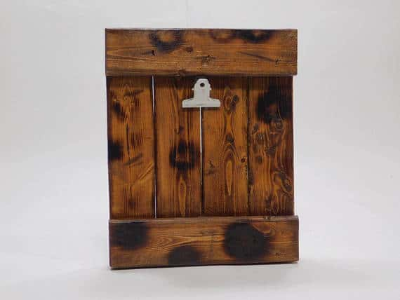 Reclaimed wood picture frame with a woody texture.