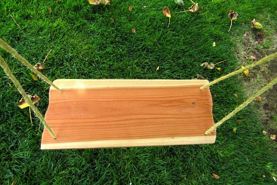 Handmade rectangular swing made of wood.