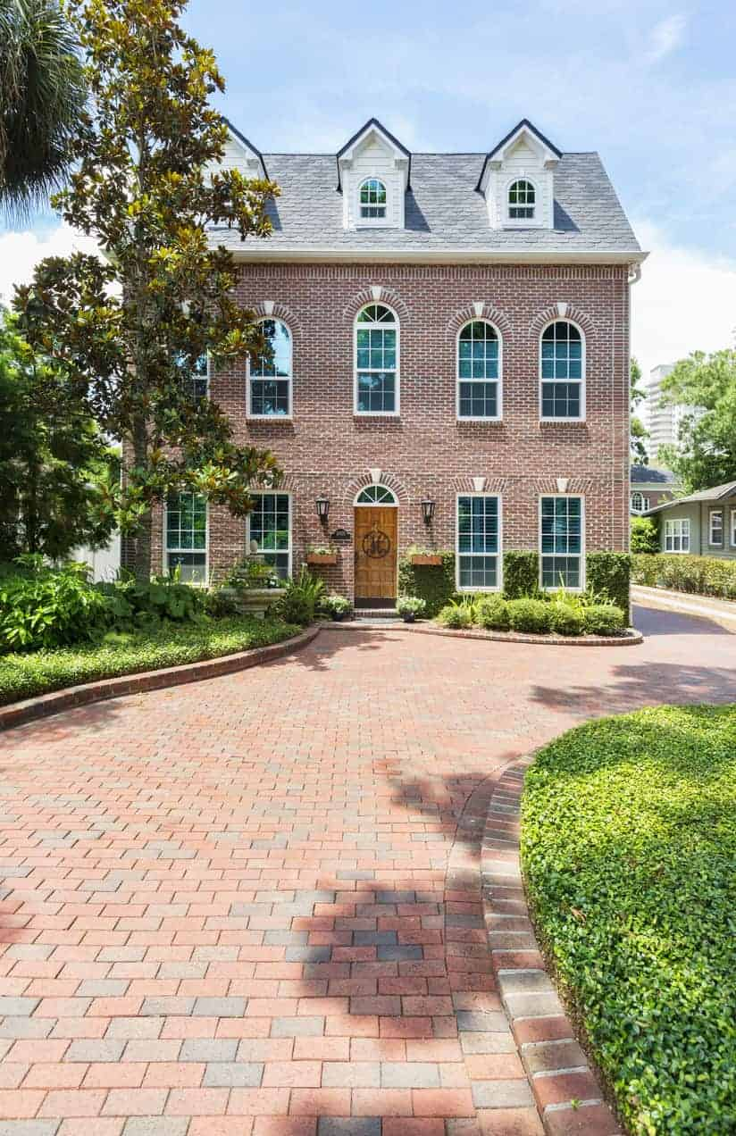 Gorgeous home with red brick paver driveway