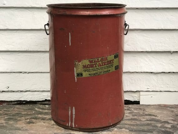 A heavy-duty, red storage bucket.