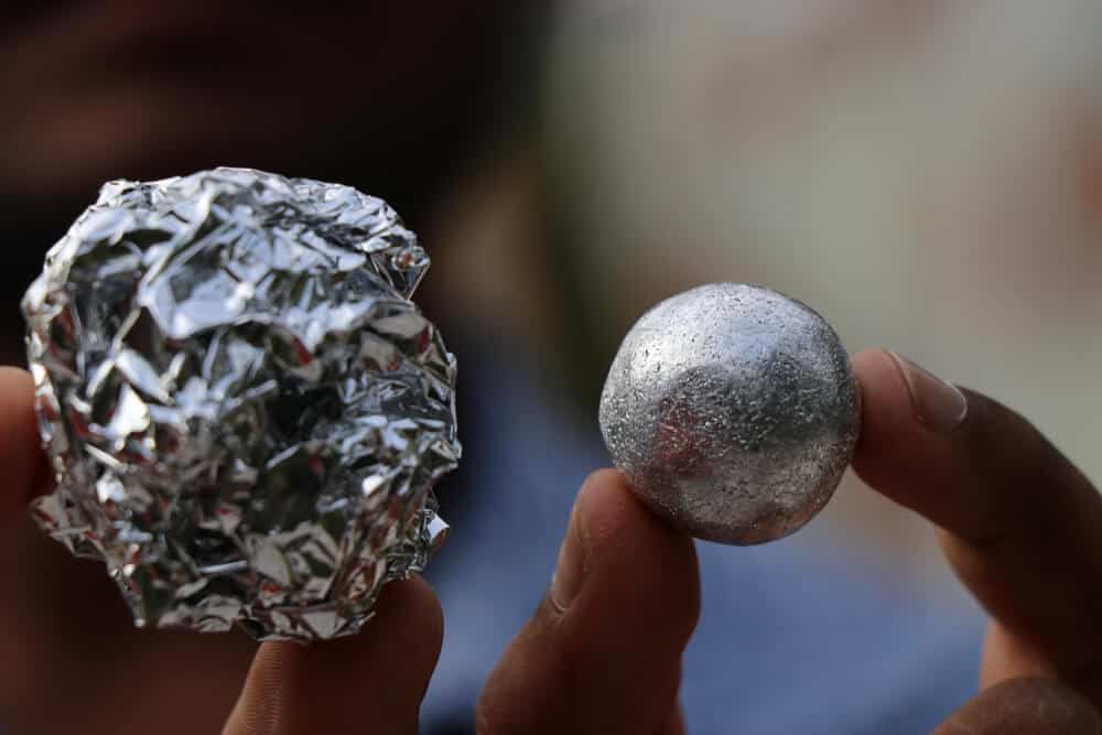 Rounded aluminum foil with a rough and soft finish, respectively.