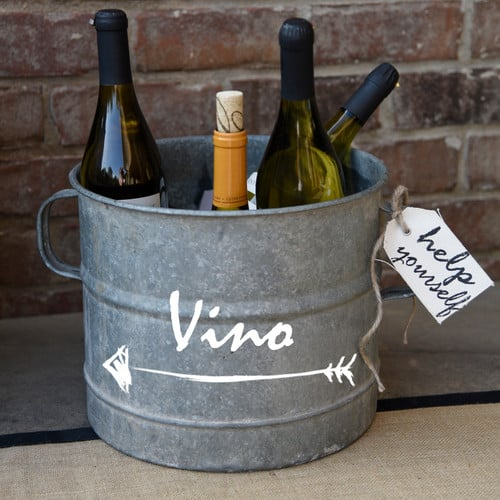 Rustic metal bucket with a hand-painted name.