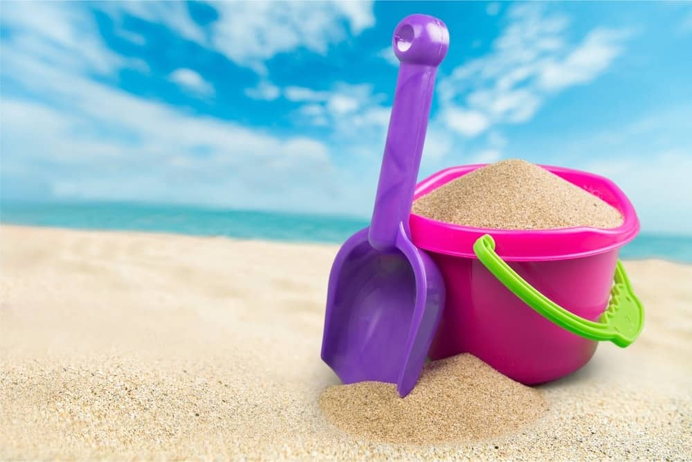 A pink, plastic sand bucket with a plastic hand shovel included.