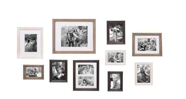 A set of wooden picture frames with a rustic finish.