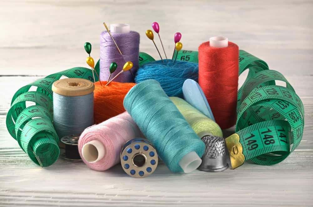 Spools of sewing thread in various colors.