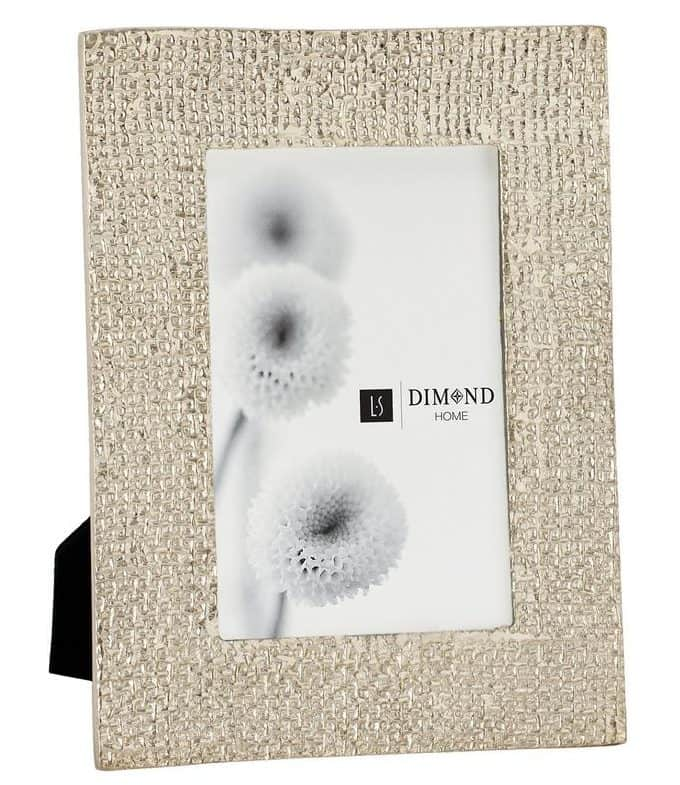 Silver-plated picture frame with a ripple texture.