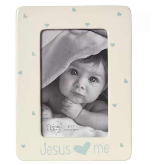 Small, ceramic picture frame with a picture of a baby girl.