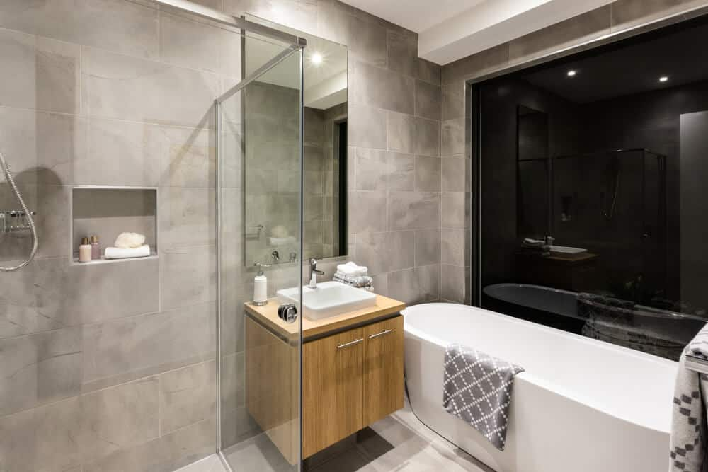 A wooden square vanity besides the bathtub.