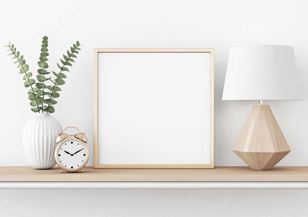 Medium-sized, square picture frame with a metal structure.