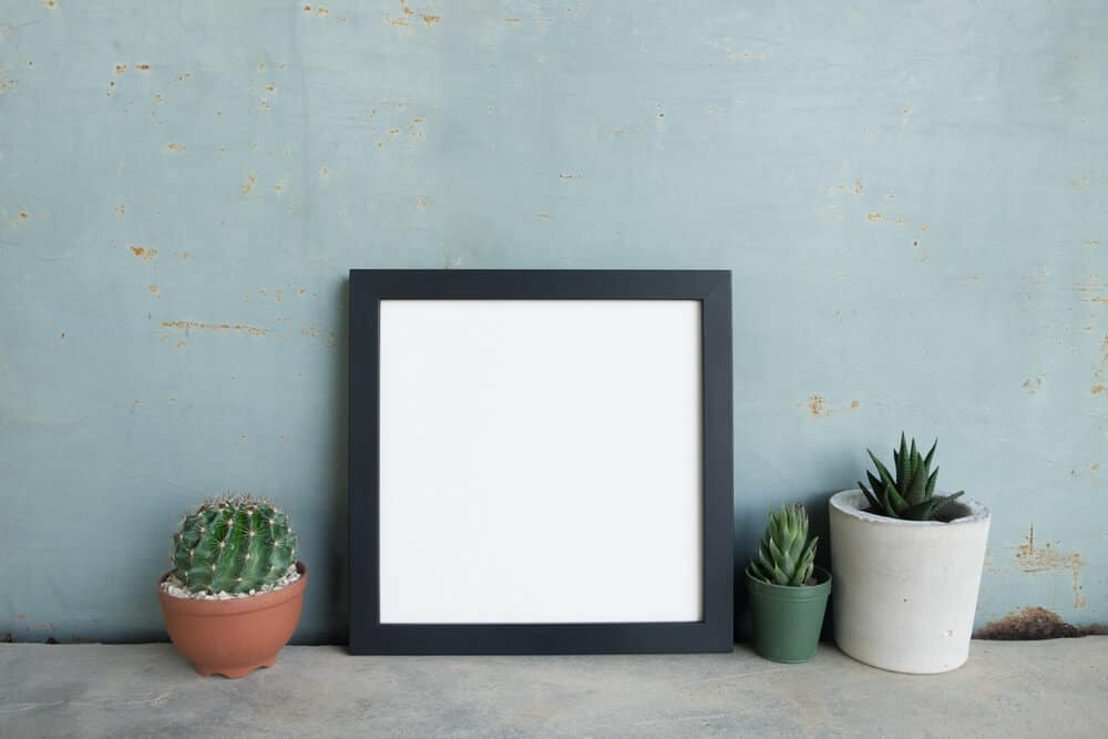 A standard picture frame with a solid black frame.
