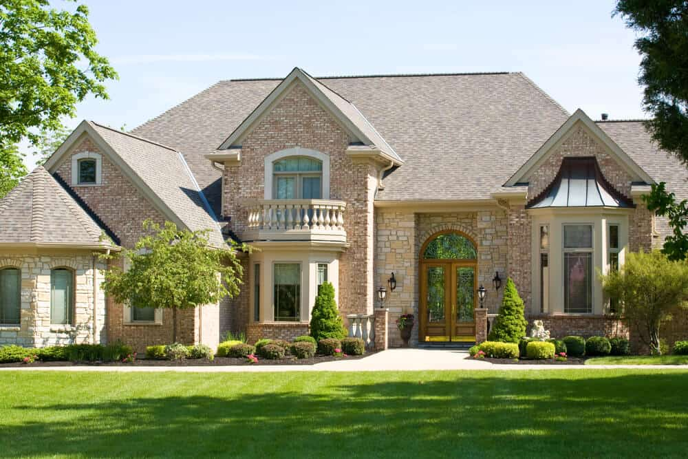 A stone house looking fresh and modern with its light-colored exterior and contemporary finish.