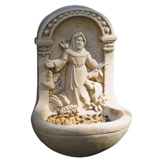 A statue of St. Francis decorated to a bird feeder.