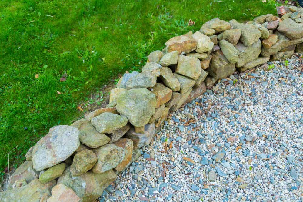 Small to medium-sized stones at the edge of the lawn.